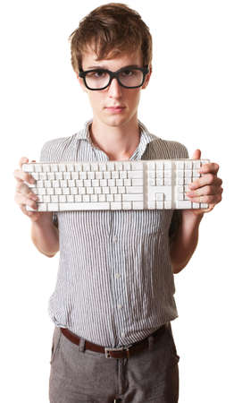 Young Caucasian man holds computer keyword over white background