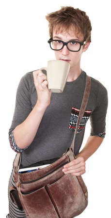 Skinny Caucasian teen sips coffee over white background Imagens