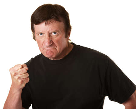 hefty: Angry Caucasian man with clenched fist over white background Stock Photo