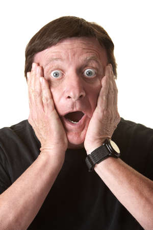Shocked mature man with hands on face over white background photo