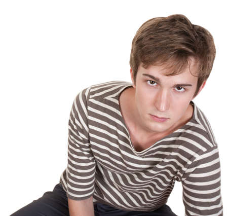 Bored young Caucasian man over white background Stock Photo - 10588742