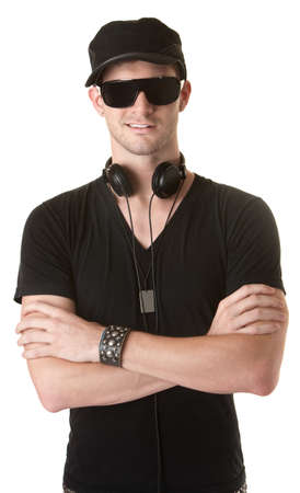 Young man in headphones with folded arms over white background