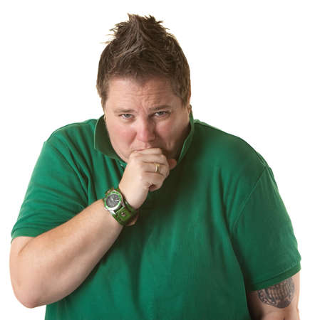 butch: Chubby Caucasian woman coughs with her mouth covered on white background Stock Photo