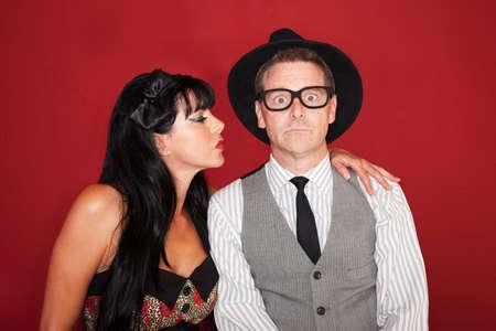 Beautiful Caucasian woman tries to kiss a shy man photo