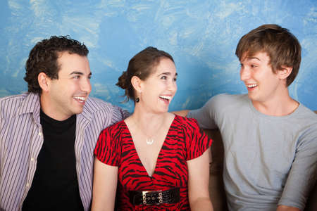 unbuttoned: Group of three happy friends over blue background