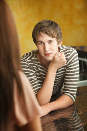 Handsome young Caucasian man with woman in kitchen Stock Photo - 10833411