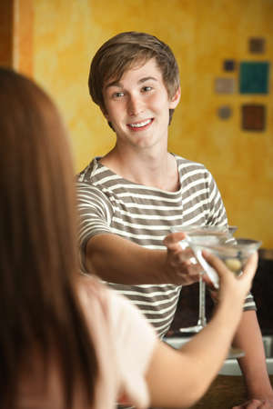 Young Caucasian man and girlfriend with martini glasses Stock Photo - 10833407