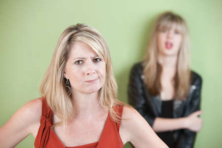 rebellious: Angry mom with daughter in the background