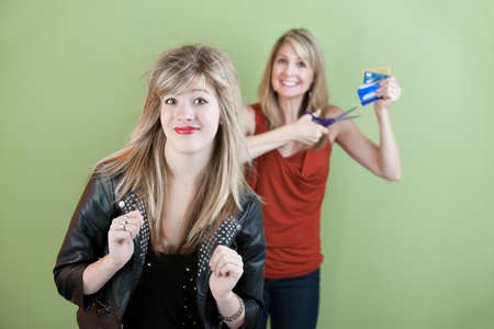 Happy mom gestures to destroy daughter photo