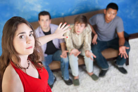 Beautiful young Caucasian lady with three disappointed men photo