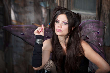 Beautiful and Caucasian fairy holds a cigar