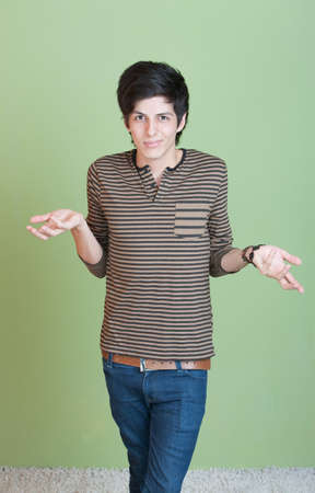 deny: Young Hispanic man gestures he doesnt know anything Stock Photo