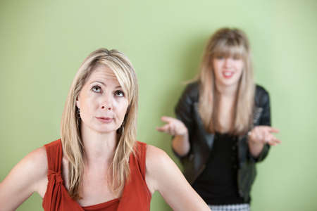 disobey: Disappointed mom with frustrated daughter in background