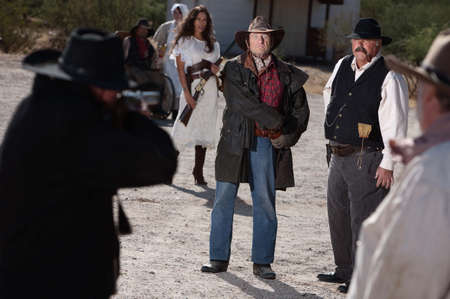duel: A gunfight is about to begin in an old western town. Stock Photo