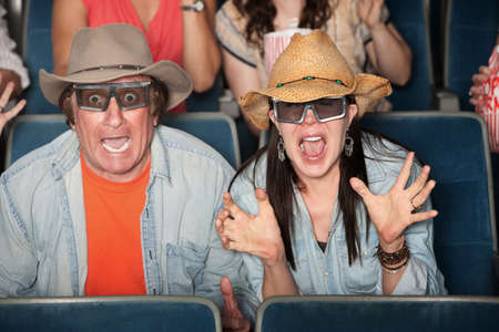 Couple with hats and 3D glasses scream out loud  photo