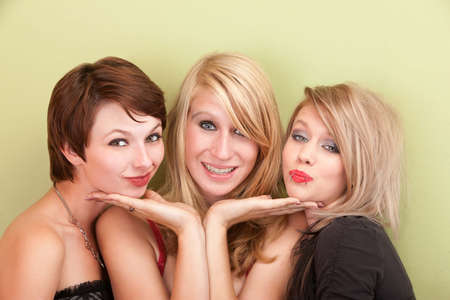 Three playful teen girls make faces for the camera. photo