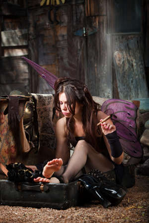 fishnet stockings: Lonely fairy in rustic scene smokes a cigar