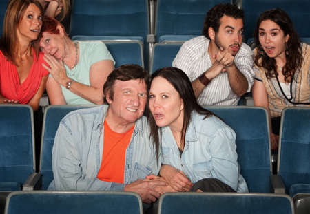 disgusted: Sad and disgusted groups of people in a theater
