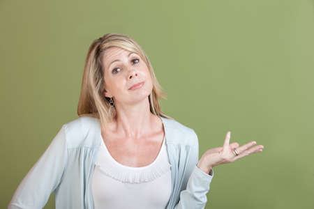 skeptic: Mature Caucasian woman holds her palm up