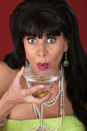 Excited Retro-styled woman with martini glass photo