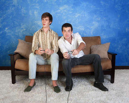Two Caucasian friends with controller play video game  photo