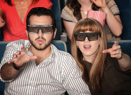 amaze: Amazed Caucasian couple with 3D glasses in theater seats