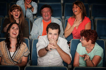 Group of seven audience watching movie laugh in theater Stok Fotoğraf