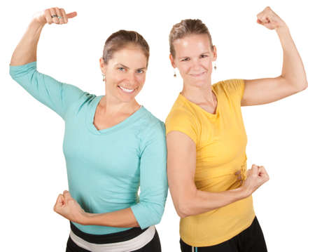 show off: Two smiling women show off their biceps