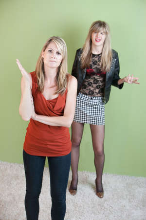 inappropriate: Mom angry with annoyed daughters provocative clothing