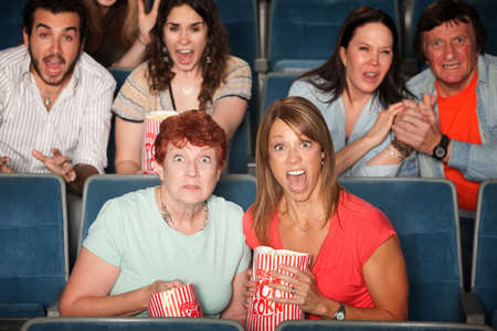 spectator: Scared people in the audience with their mouths open Stock Photo