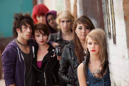 seriously: Gang of young teen punks stare seriously towards the camera.