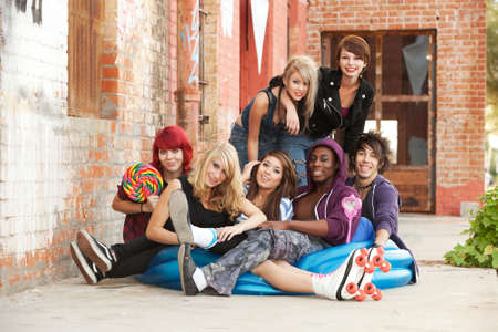 Young and crazy punk teens pose for a gorup shot behind an abandoned building downtown. Stock Photo - 13457063