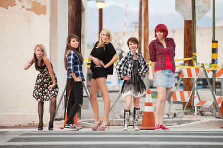 Young, beautiful, punky teen girls strike poses for the camera. photo