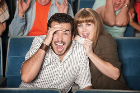 Scared couple screaming out loud watch horror movie photo