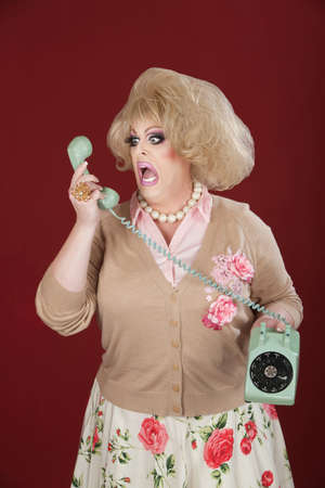 Emotional queen screams at a rotary telephone photo