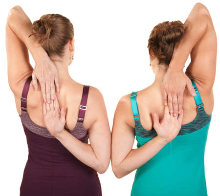 back exercise: Back view of women stretching their arms over white background
