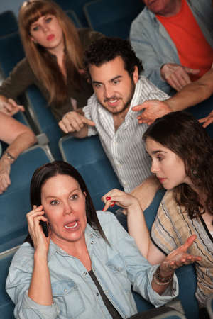 bad manners: Loud woman on phone frustrates audience in theater