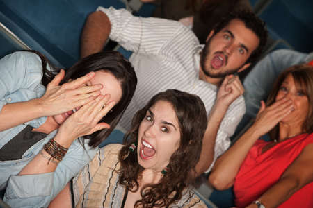 Scared group of screaming people in theater photo