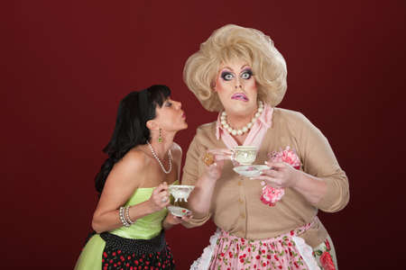 Woman with cup of tea tries to kiss shocked drag queen