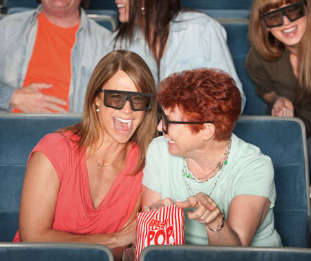 comedy show: Groups of people in the audience with 3D glasses and laughing