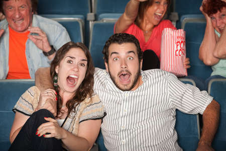 Group of people in audience react in fear