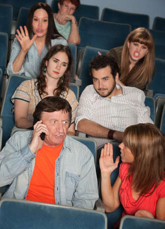 irked: Man on phone call irks audience in theater