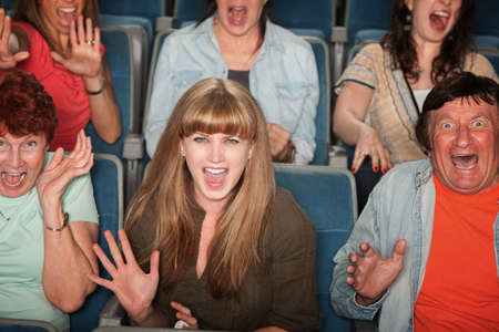 horrified: Group of screaming people at the movies