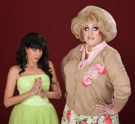 disgusted: Innocent looking woman and disgusted drag queen Stock Photo