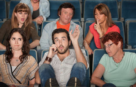 silent film: Loud bearded man on phone annoys the audience in theater