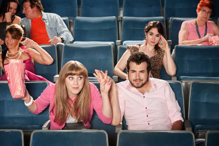 grandstand: Rude young woman with man in theater audience