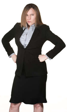 Angry Caucasian business woman with hands on hips