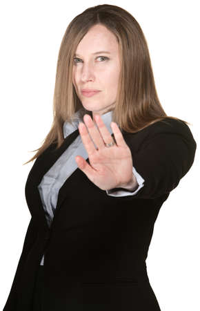 Serious Caucasian business woman gestures to stop