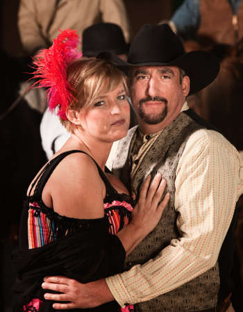 Handsome man and woman in old west costumes photo