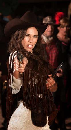 gunfighter: Female Native American gun fighter with revolver and dagger